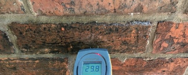 A picture containing device, old, stone, meter Description automatically generated